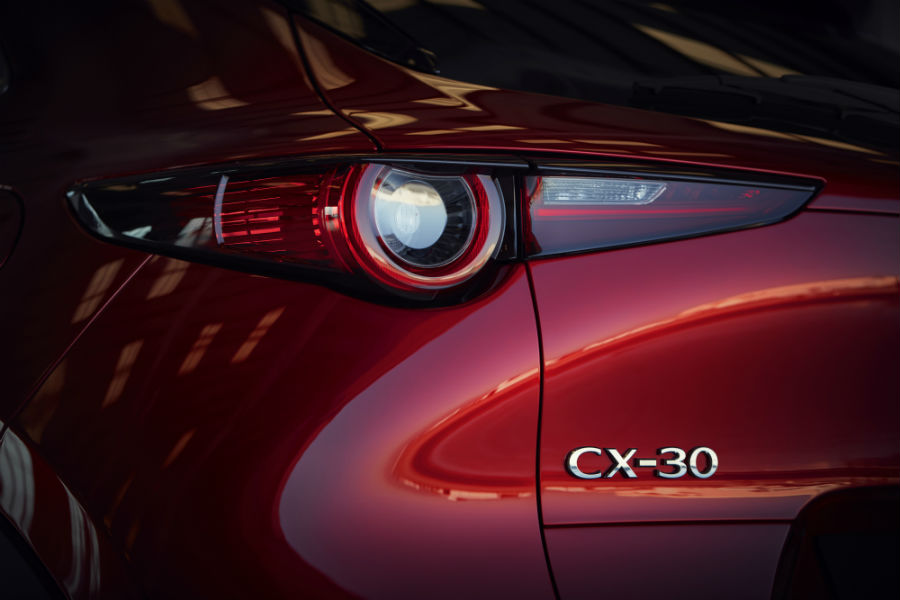 A close up photo of the CX-30 badge and taillight assembly on the 2020 Mazda CX-30.