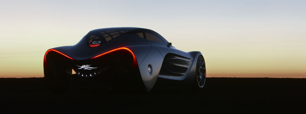 A photo of a Mazda concept vehicle parked in the desert.