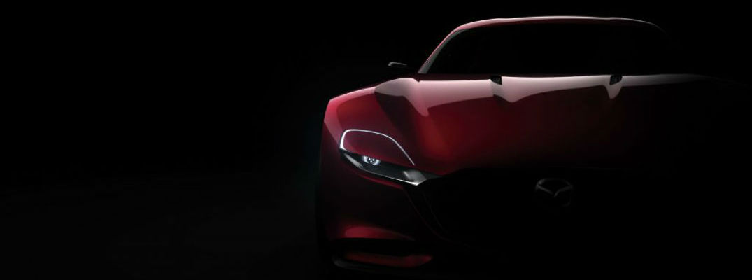 A photo of a Mazda concept vehicle in silhouette.