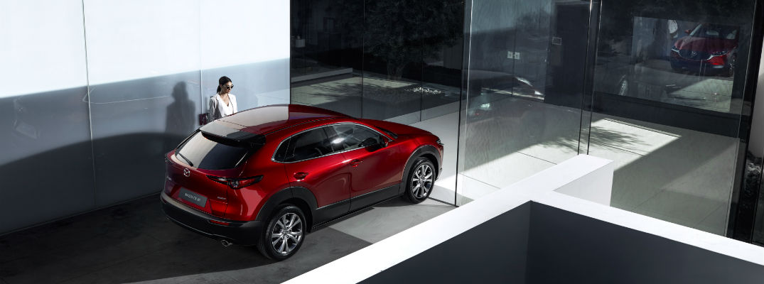 An overhead photo of the Mazda CX-30 parked in front of a house.