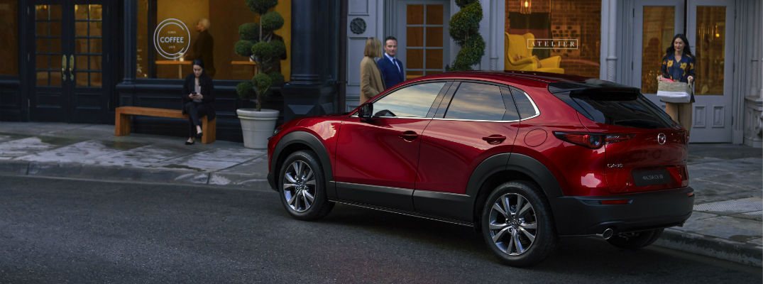 A left profile photo of the Mazda CX-30 on the side of the road.