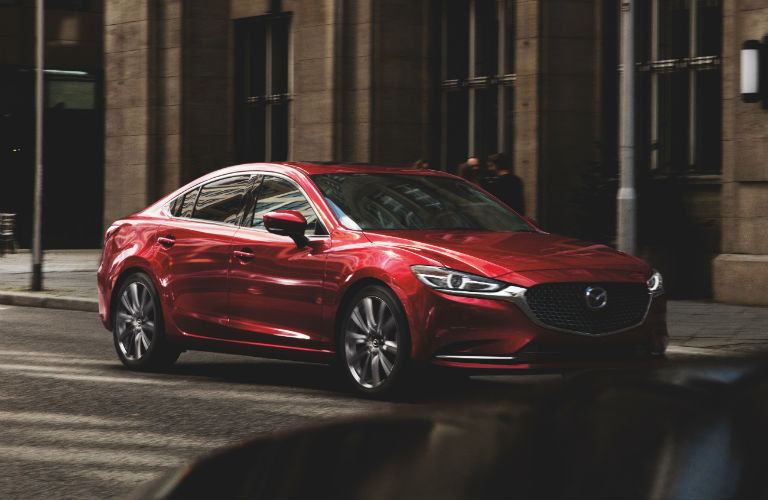 A front right quarter photo of the Mazda6 parked on the side of the road.