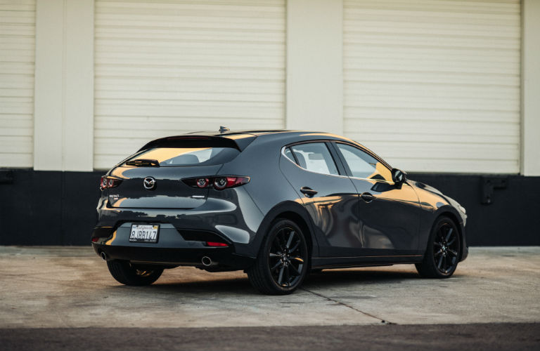 A rear right quarter photo of the 2020 Mazda3 Hatchback.
