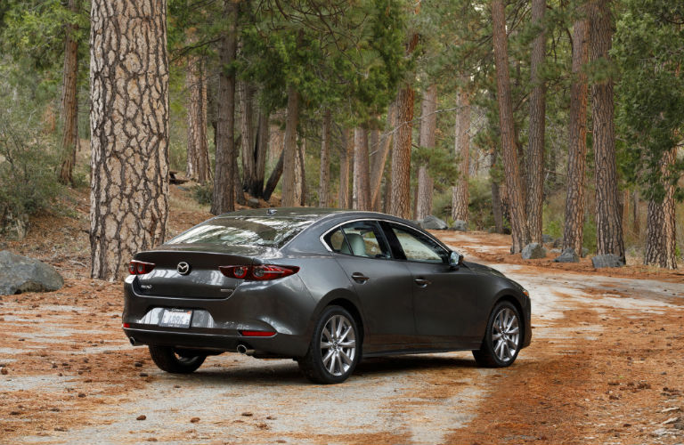 A photo of the 2020 Mazda3 Hatchback parked in the woods.