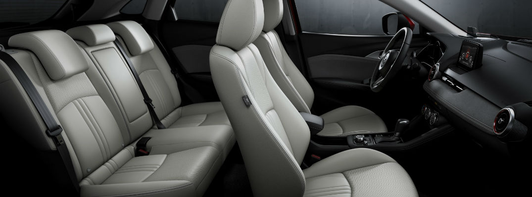 A photo of the front and rear seats in a Mazda crossover SUV.