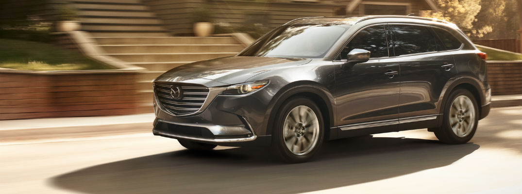 A left profile photo of the 2019 Mazda CX-9 on the road.