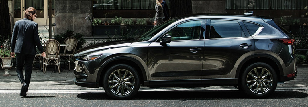 2020 Mazda CX-5 parked with man walking in front of the vehicle