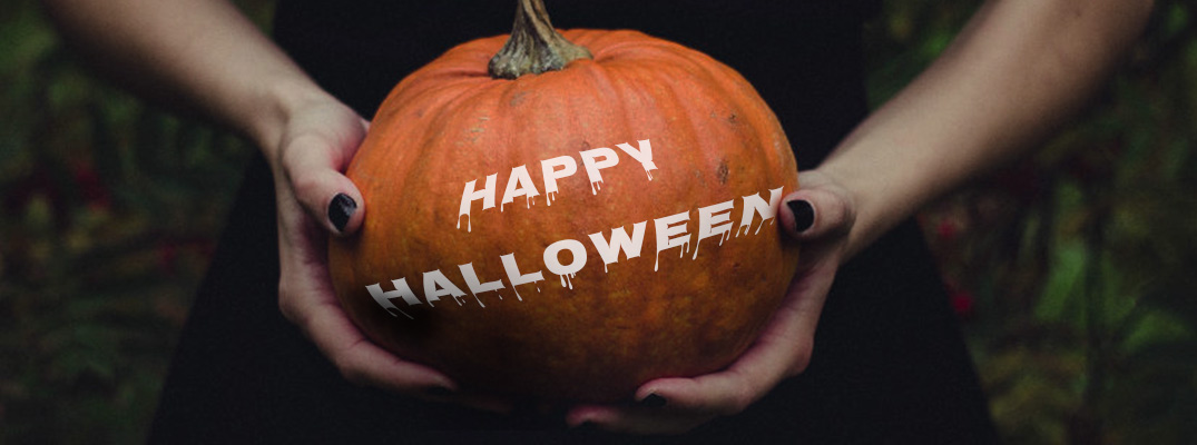 2 Hands Holding Pumpkin with White Happy Halloween Text