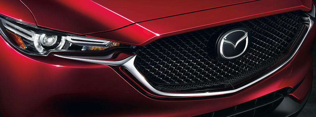 Close Up of Red 2017 Mazda CX-5 Grille and Headlights with Mazda Logo on Grille