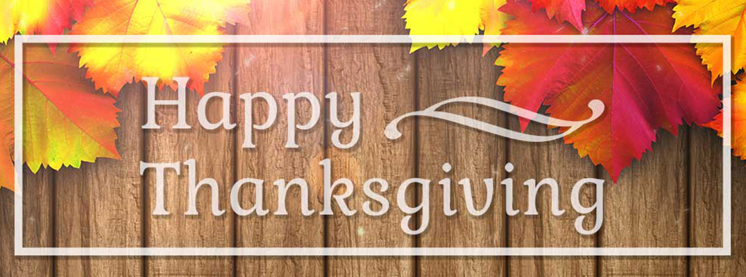 Wood Background with Fall Leaves and White Happy Thanksgiving Text inside White Box