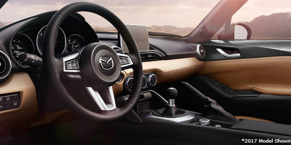 2017 Mazda MX-5 Miata Steering Wheel and Dashboard with White Asterisk and Text in Corner 2017 Model Shown