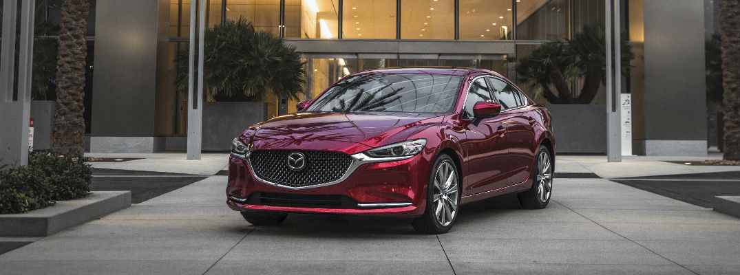 Red 2018 Mazda6 Front Exterior Parked in Front of Modern Building