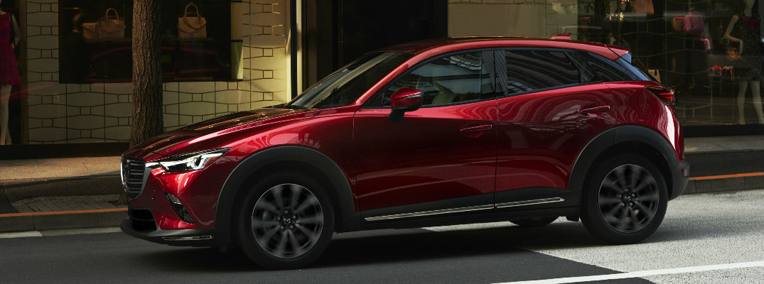 Red 2019 Mazda CX-3 Parked on City Street at Twilight
