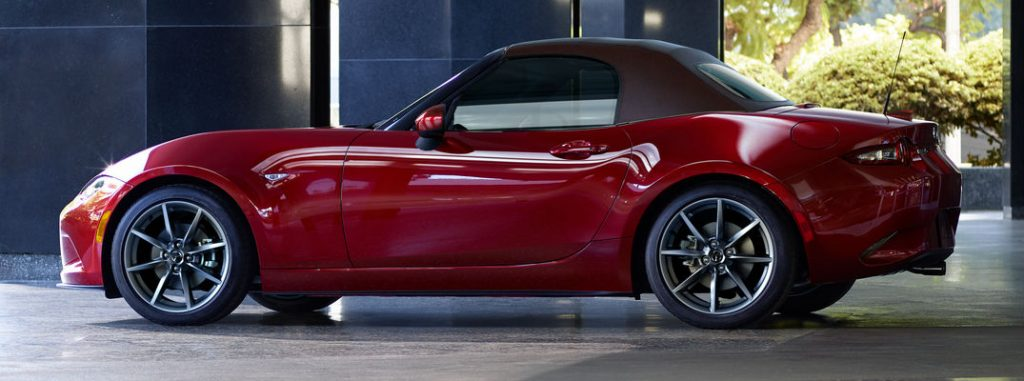 Red 2019 Mazda MX-5 Miata Side Exterior in a Parking Structure