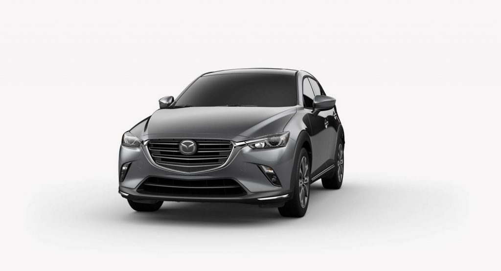 Machine Gray Metallic 2019 Mazda CX-3 on a White Background