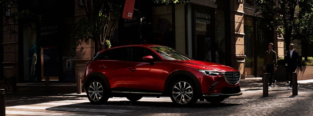 Soul Red Crystal metallic 2019 Mazda CX-3 on a Cobblestone City Street