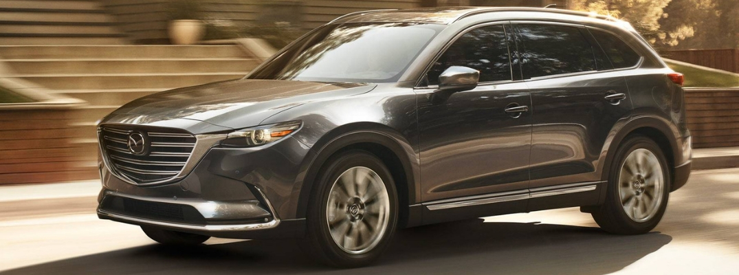 Grey Mazda CX-9 Driving on a Road