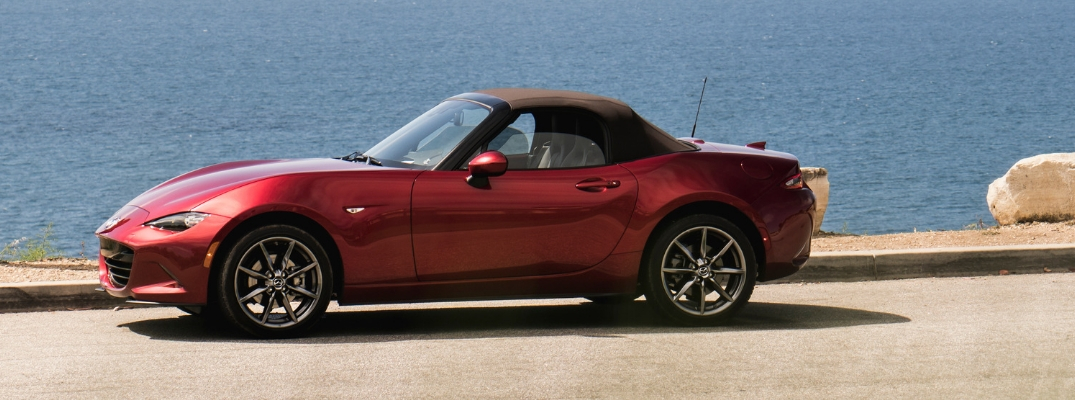Red 2019 Mazda MX-5 Miata with Brown Soft Top Parked on the Coast