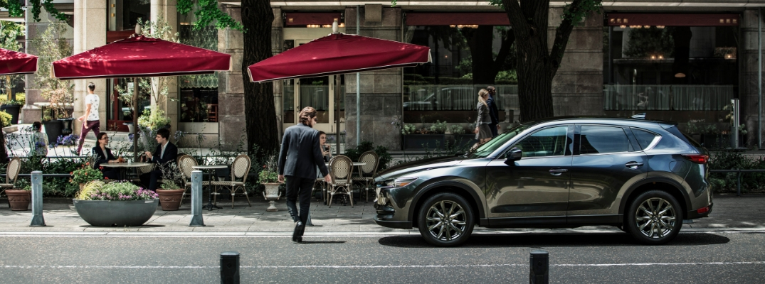 Gray 2019 Mazda CX-5 Parked on City Street by a Cafe