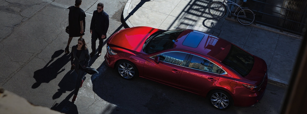 Overhead View of Red 2019 Mazda6 at a Crosswalk with Pedestrians in Front