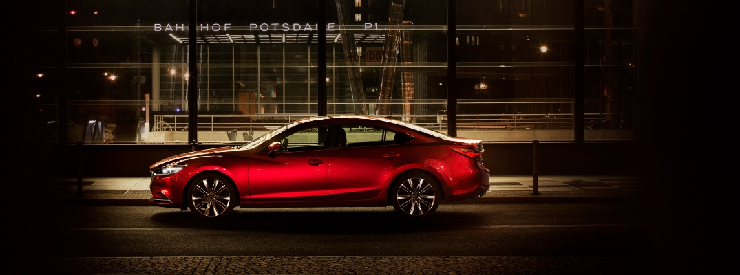 Red 2019 Mazda6 in Front of Glass Building