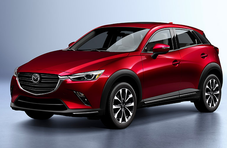 Red 2019 Mazda CX-3 on a Gray Background