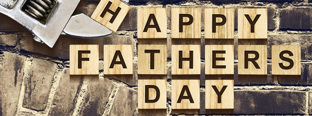 Wood Blocks on Brick Background that Spell Happy Father's Day