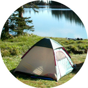 Tent on Grass Next to a Lake