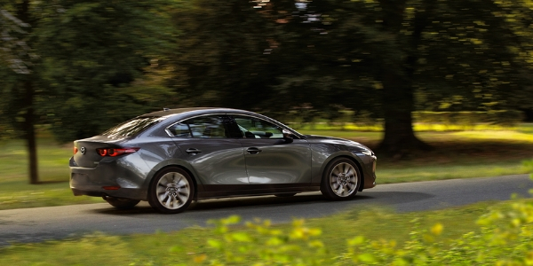 Gray 2019 Mazda3 Sedan Rear Exterior on a Country Road