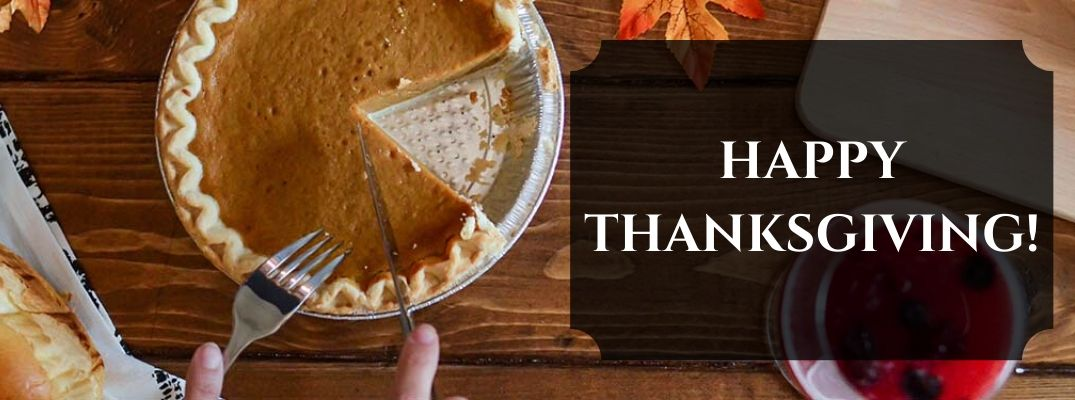 Pumpkin Pie on a Table at Thanksgiving with Black Text Box and White Happy Thanksgiving! Text