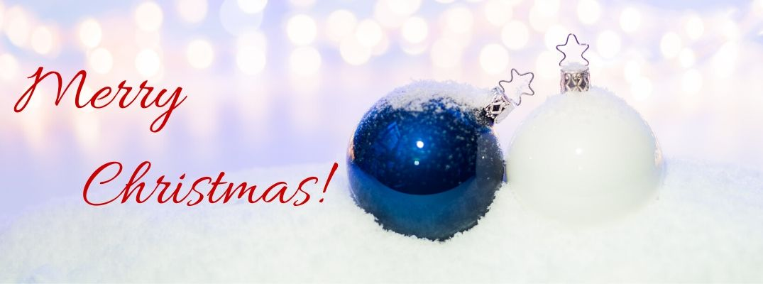 Blue and White Christmas Ornaments in Snow with Red Merry Christmas! Text