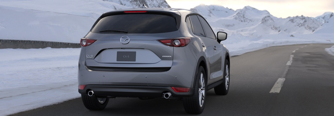 2020 Mazda CX-5 driving down a snowy road