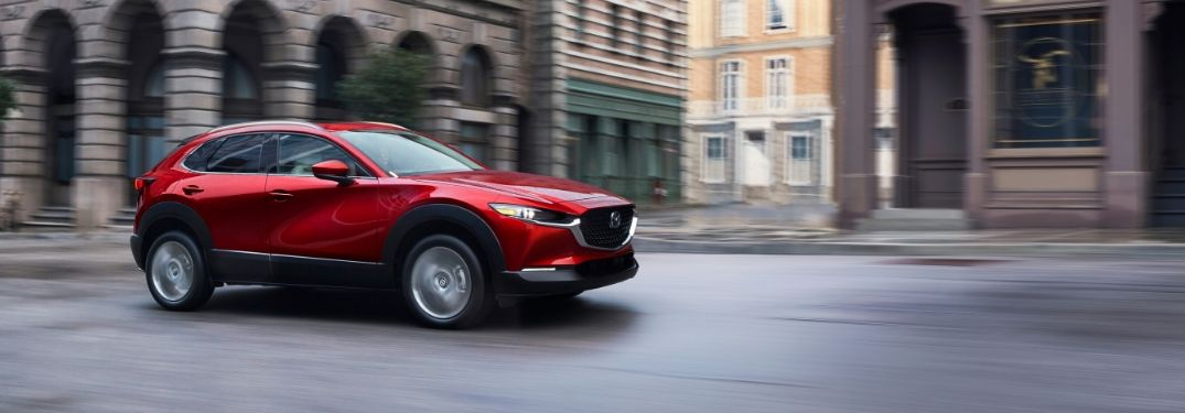 Red 2020 Mazda CX-30 Driving on a City Street