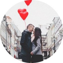 Couple Kissing in a City Street with Red Heart Balloons