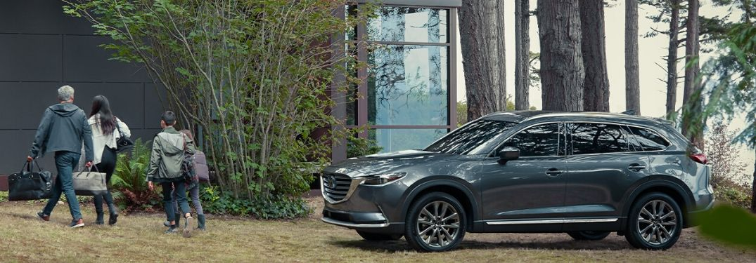 Gray 2020 Mazda CX-9 and Family By a Cabin in the Woods