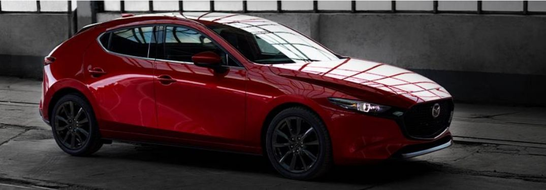 Red 2020 Mazda3 Hatchback in a Garage