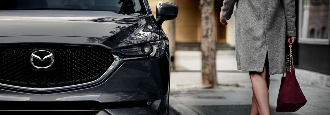 Close Up of 2020 Mazda CX-5 Grille with Woman Walking Next to It