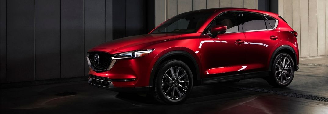 Red 2021 Mazda CX-5 Side Exterior in a Parking Garage