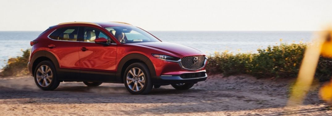 Red 2021 Mazda CX-30 on a Beach