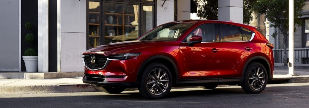 Red 2021 Mazda CX-5 on a City Street