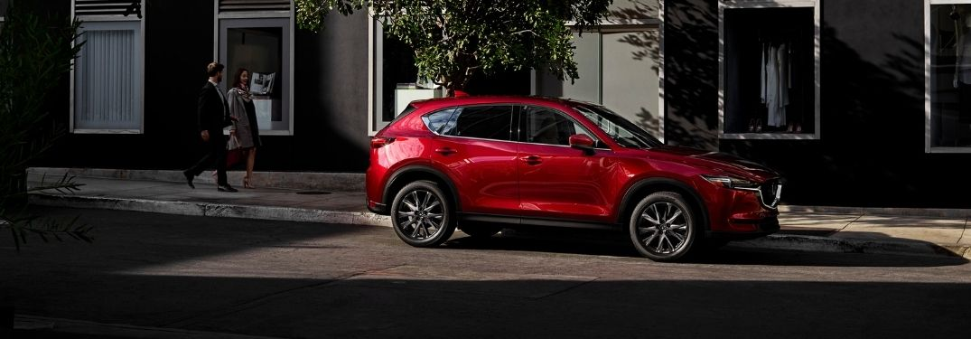 Red 2021 Mazda CX-5 Side Exterior on a City Street