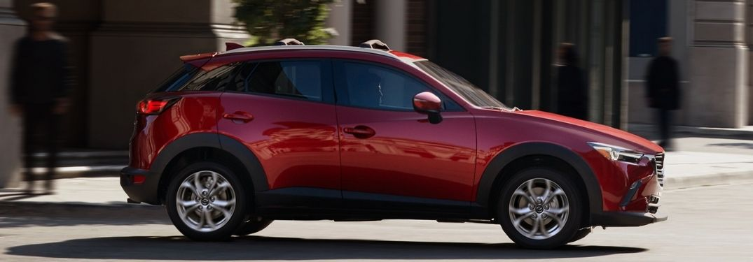 Red 2021 Mazda CX-3 Side Exterior on a City Street
