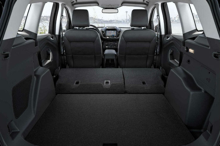 Rear seats folded down in the 2018 Ford Escape for storage ...