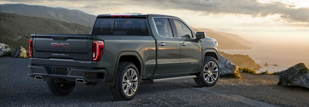 Passenger side exterior view of a black 2019 GMC Sierra 1500 Denali