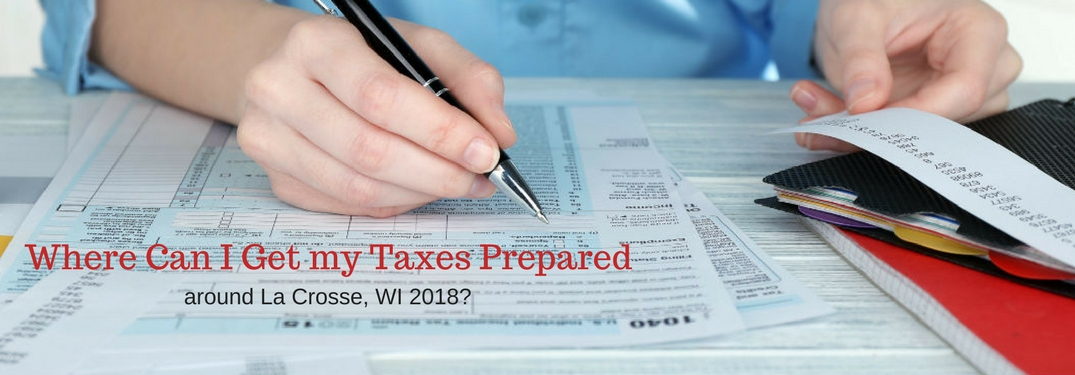 Where can I get my taxes prepared around La Crosse, WI in 2018, text on an image of a man filling out paperwork