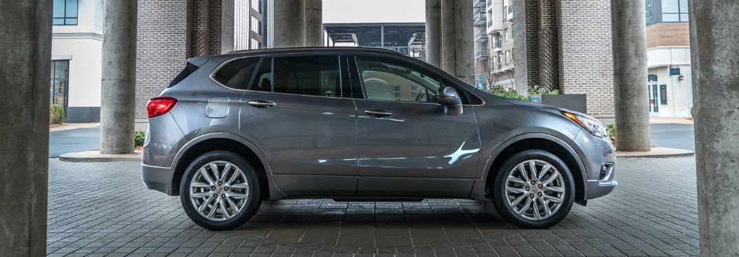 Passenger side exterior view of a gray 2019 Buick Envision