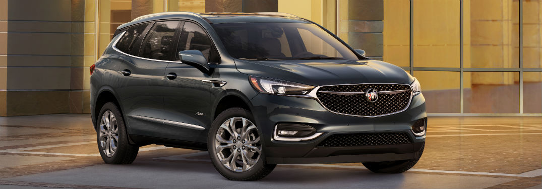 Passenger side exterior view of a black 2019 Buick Enclave Avenir