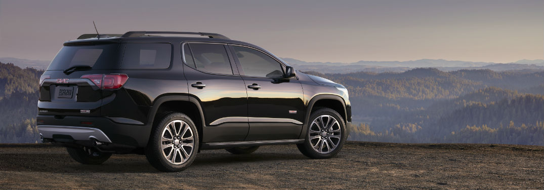 Passenger side exterior view of a black 2019 GMC Acadia