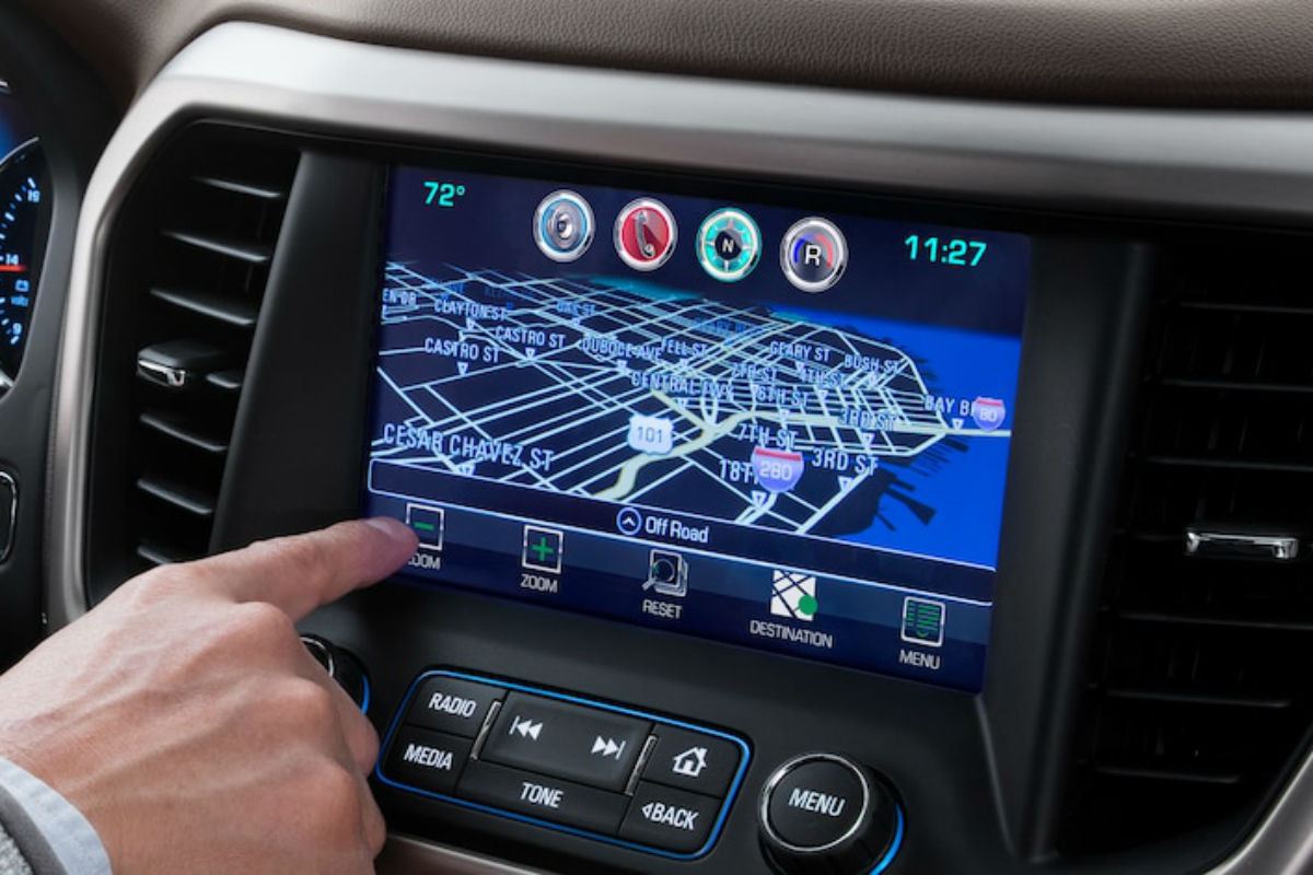 Man using navigation on the touchscreen display of the 2019 GMC Acadia