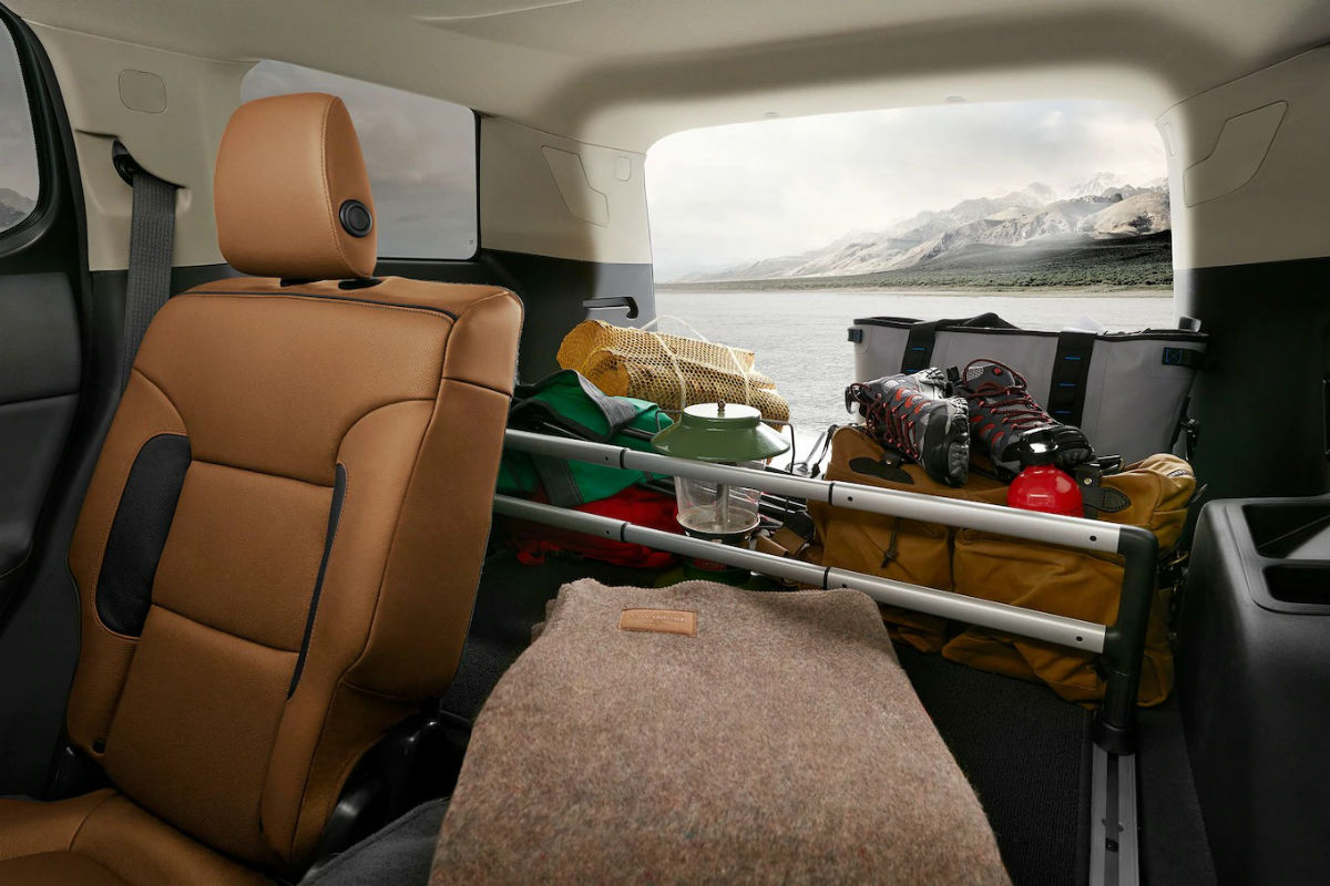 Rear storage area of the 2019 GMC Acadia loaded with cargo